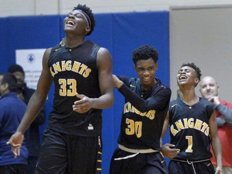 McQuaid celebrating game winning block with the return of former player Isaiah Stewart.