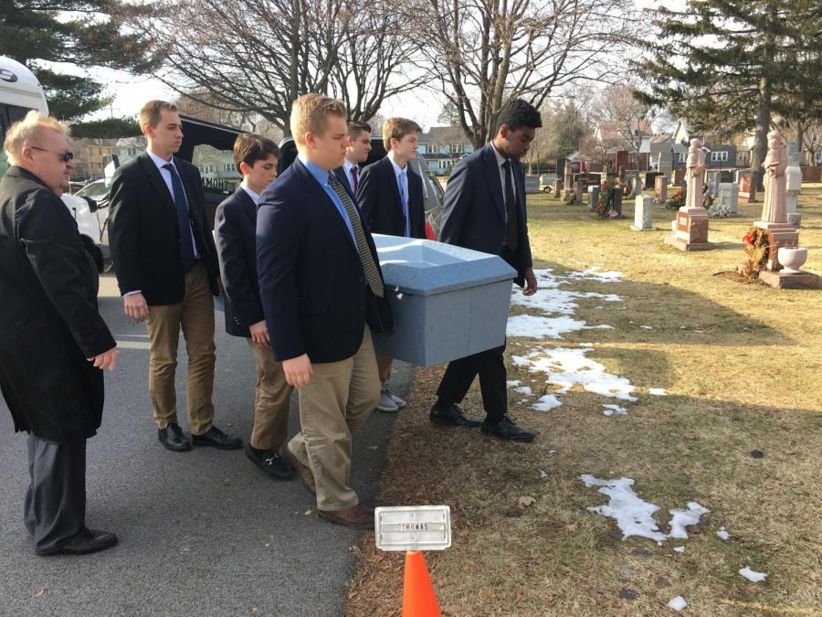 Gabe+Gelke%2C+%2719+joins+classmates+while+serving+in+the+McQuaid+Pallbearer+Ministry.