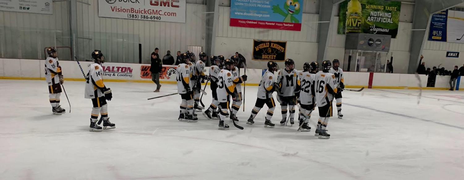 The Hockey Knights celebrate a win after defeating Rush-Henrietta at Thomas Creek arena Thursday.