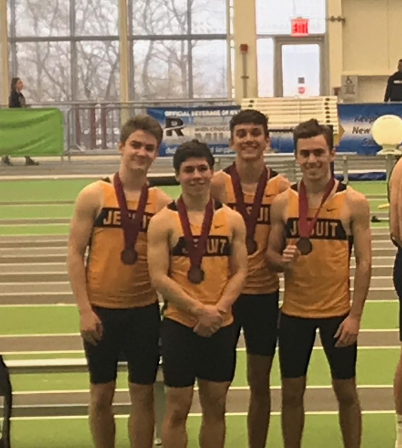 The 4x400 relay team poses with their medals after capturing 8th place at States. From left to right (Howlett, Passero, Perozzi, Ryder)