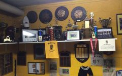 The shelf that's home to  valued plaques and pictures of some of the greatest runners to come through McQuaid.