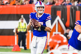 Buffalo Bills Quarterback Josh Allen attempts to throw a completion against Cleveland Browns. Allen set Franchise records during the 2020-21 season with 4,544 passin yards.