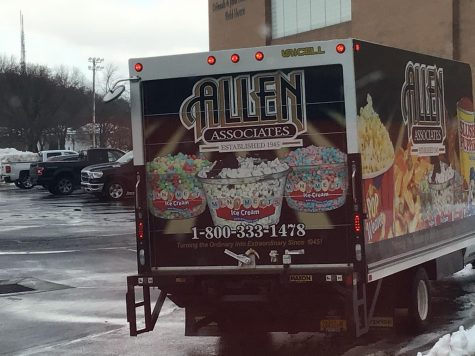 This is the vendor for Mini Melts Ice Cream, Allen Associates. They are leaving after restocking the vending machine at McQuaid Jesuit High School.