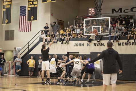 McQuaid students watch the faculty-senior basketball game from above. Due to the COVID-19 virus, McQuaid students might not be able to cheer on their fellow brothers.